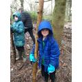 Ben and Louis gathering sticks
