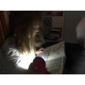 Reading with a torch - great idea!