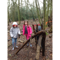 Niamh and Katie being brilliant shelter builders