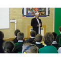 Imam , Abdul Malik, addresses school assembly