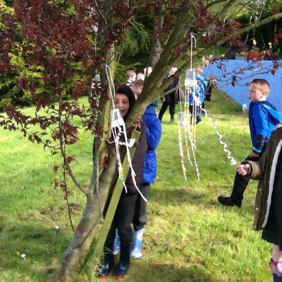 We made wind chimes and hung them on branches.