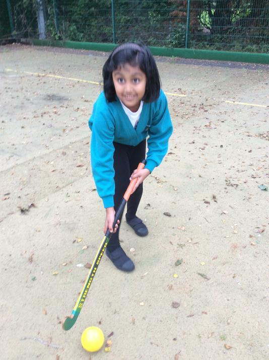 Dhiya dribbling the ball.