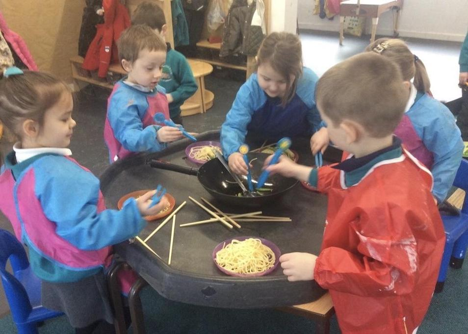 Fine motor and sensory exploration with noodles