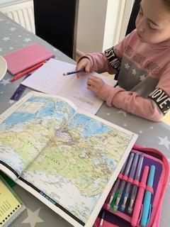 Emmy using an atlas.