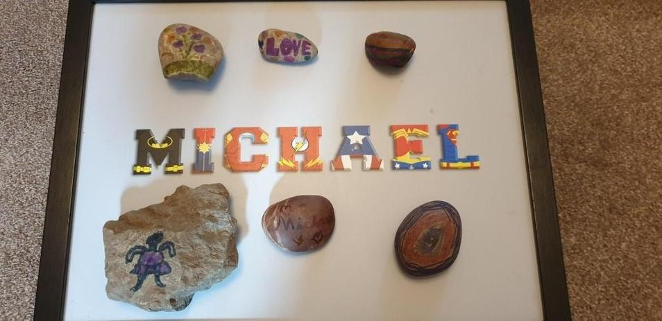 Michael has been hunting and painting rocks.