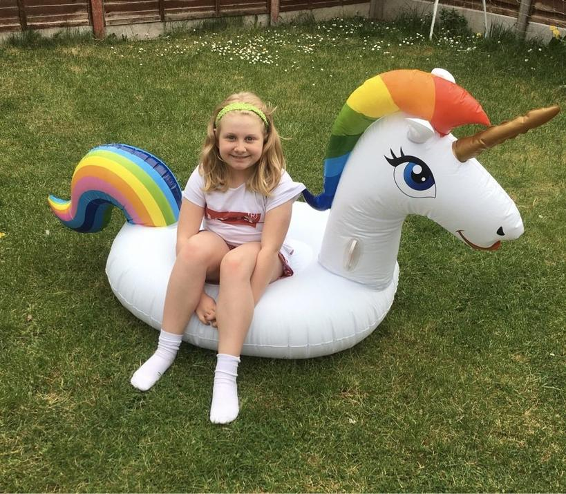 Chloe sat on her unicorn to complete her work!