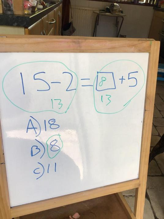 Eddie's balancing in maths.