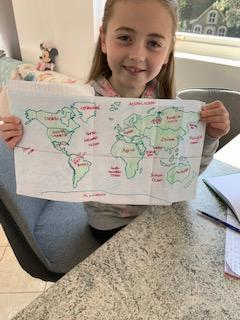 A proud Emmy and her detailed map.
