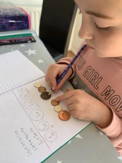 Emmy solving the coin maths problem.