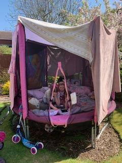 Emmy and her sisters made a den on the trampoline!