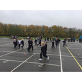 Playing warm up pe games we designed for home learning