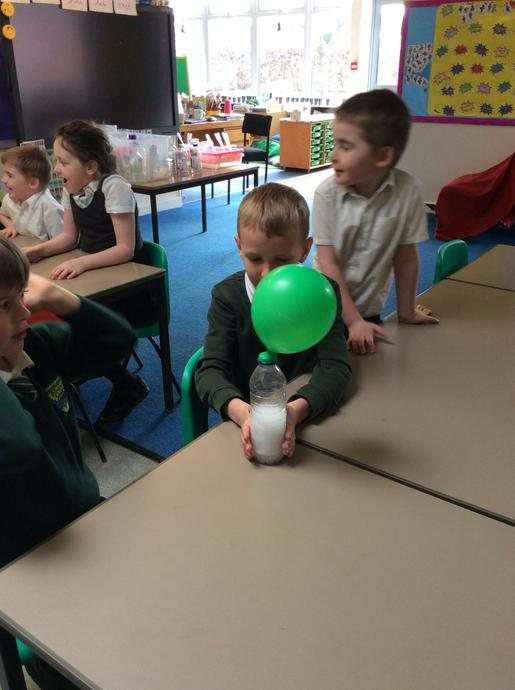 We mixed vinegar and bicarbonate of soda together.