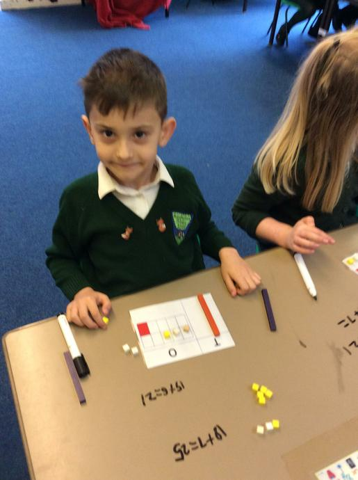 We used our place value charts to help us add.