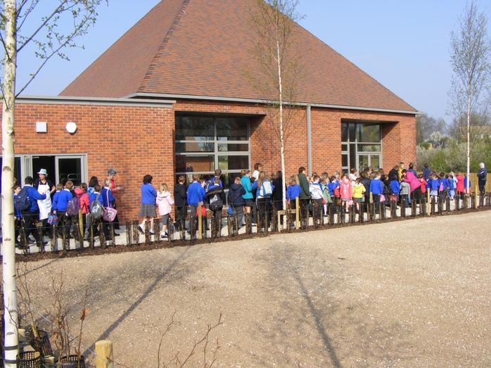 Children entering the new school building