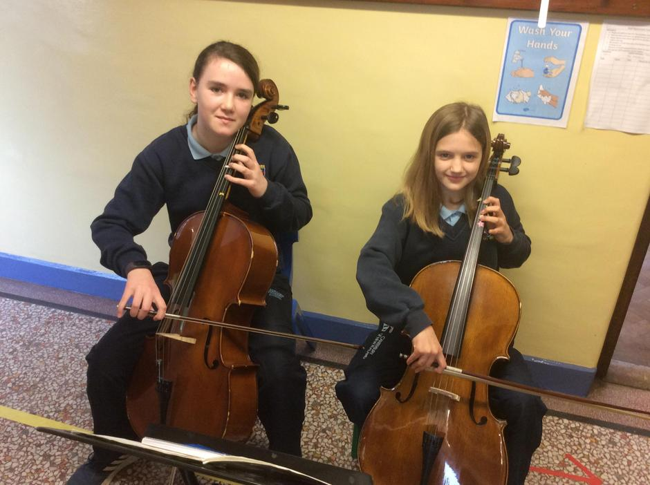 Olivia and Jessica enjoying their 'cello lesson.