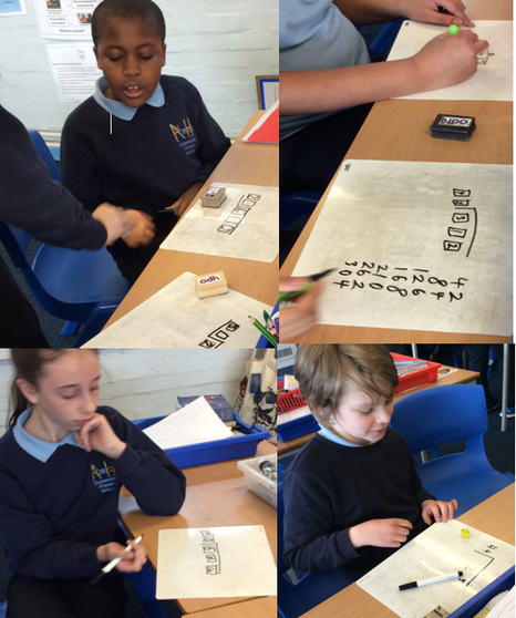 Arithmetic Friday- We enjoyed playing various practical games involving long division.
