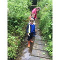 Paddling in the shallow brook with nets