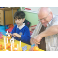 Jerry helping the children make the Christingles.