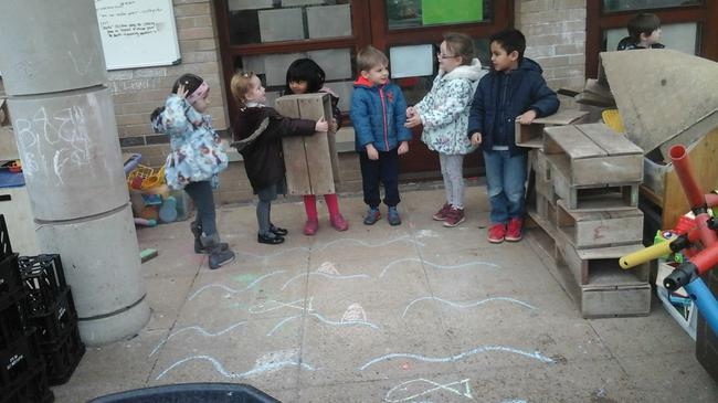 Nursery children working as a team