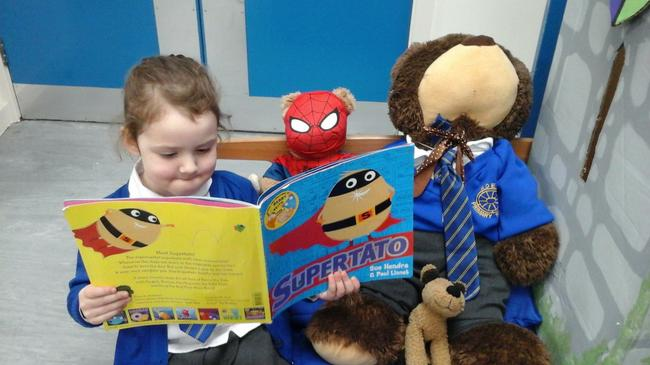 Reading Supertato with some of his friends