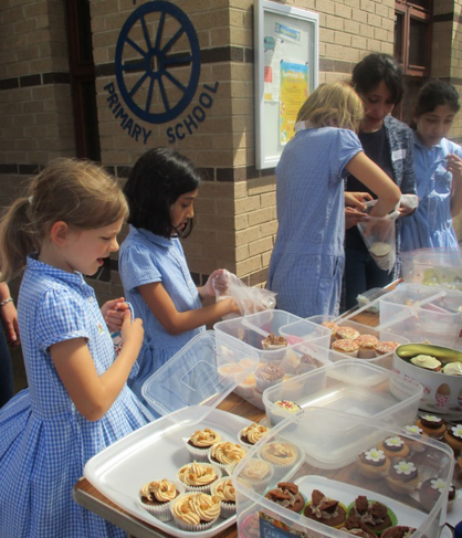 Lucy and Zahara busy selling buns.