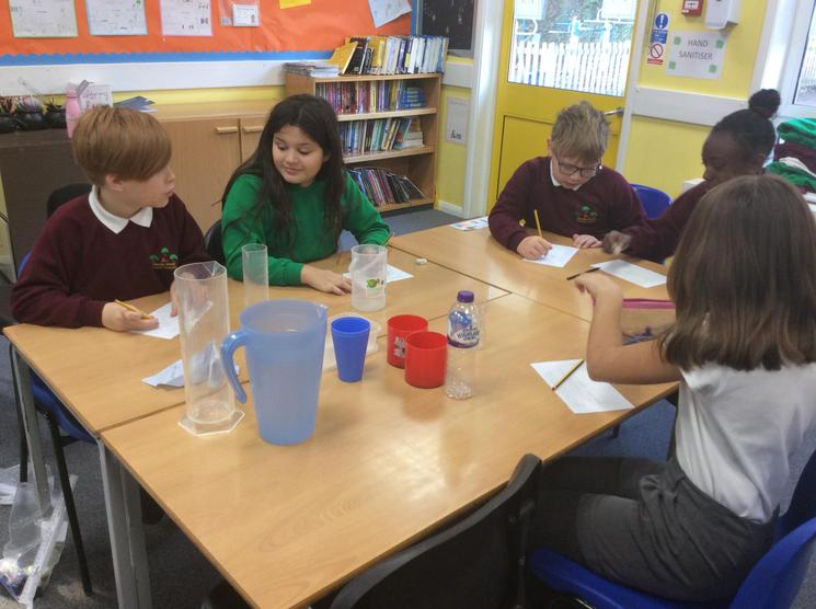 In Maths, we've been doings lots of practical (and messy) learning related to capacity!