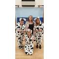 Cruella DeVille and some of her Dalmatians