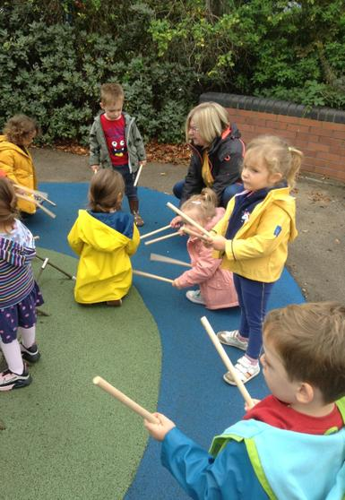 We used sticks to experiment with sounds outside.