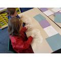 Practising letter formation in shaving foam!