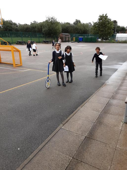Using metre sticks to measure the playground