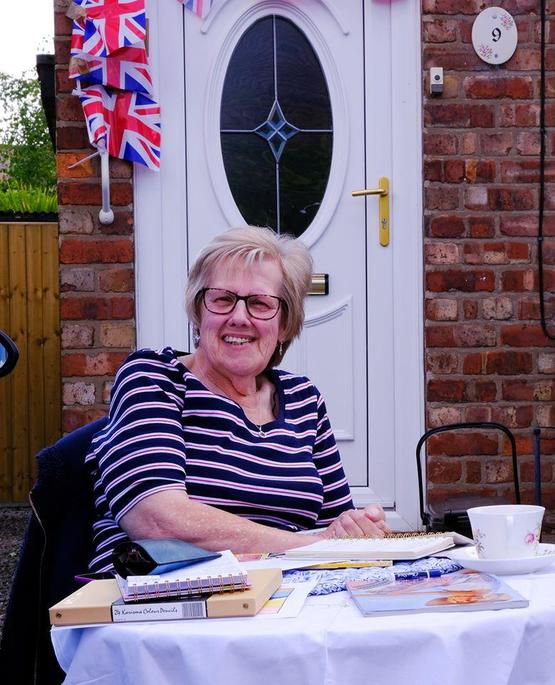 Mrs. Evans enjoyed  VE Day in her front  garden.