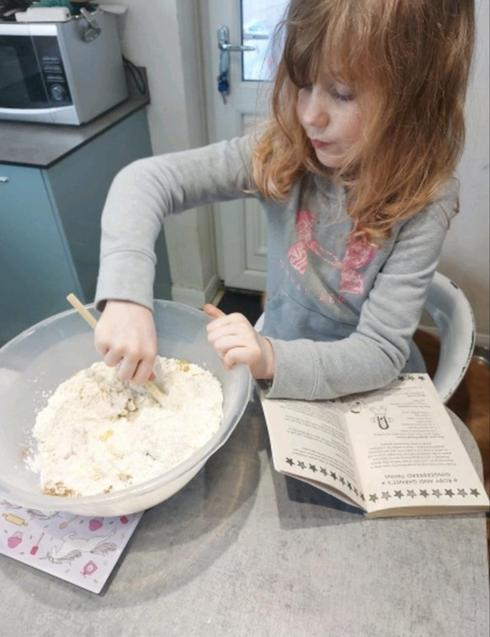 'Double Act' by Jaqueline Wilson has a ginger bread recipe in the book. Give it a read!