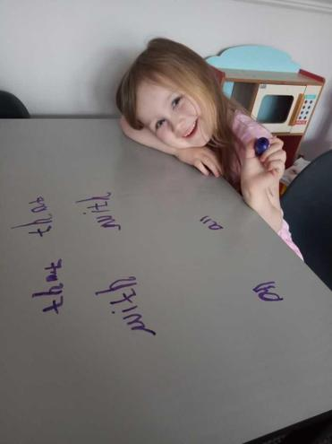 Layla writing practise on the table.jpg