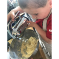 Using an electric mixer to make some yummy cakes