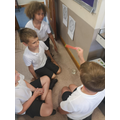 Year 3/4 act out how Hindus worship at a home shrine.