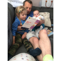 Reading to Daddy and baby brother