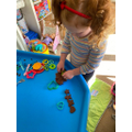 Making biscuits and chocolates with playdough