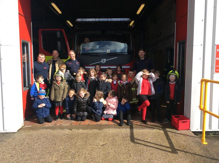 Group photo in front of the fire station.