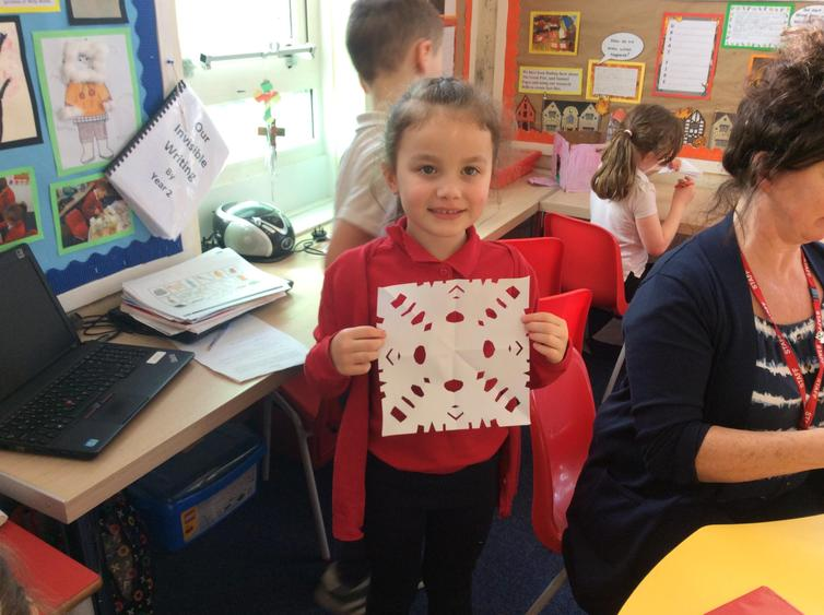 Our topic is Ice so we made paper snowflakes.