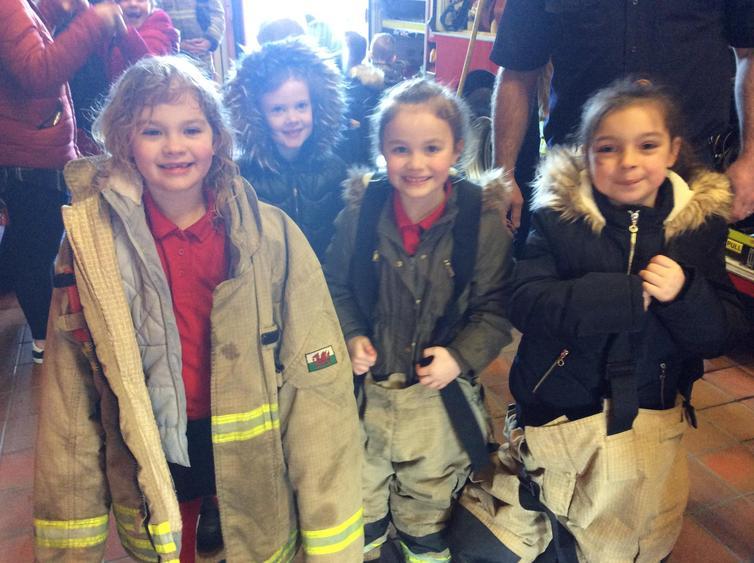 Gracie-Mae, Drew and Poppie tried on the uniforms.