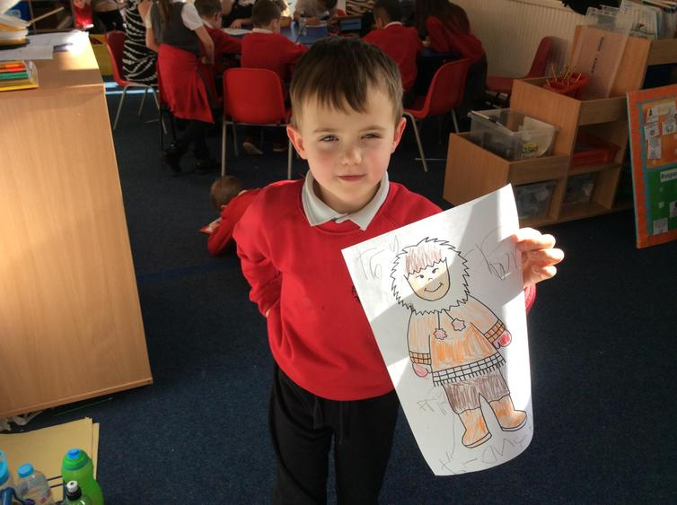Using cotton wool to decorate our Eskimo pictures.