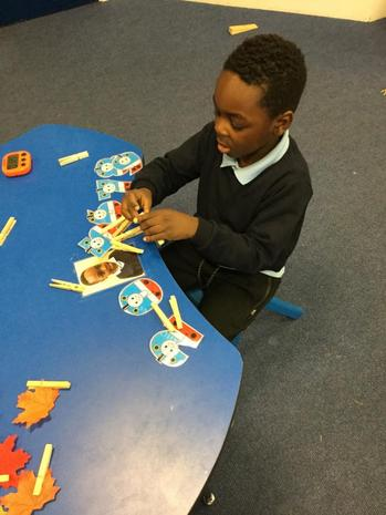 Putting the correct amount of pegs to match the number