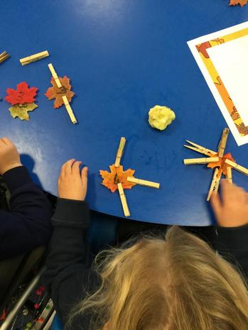 Matching pegs to the numbers on the leaves