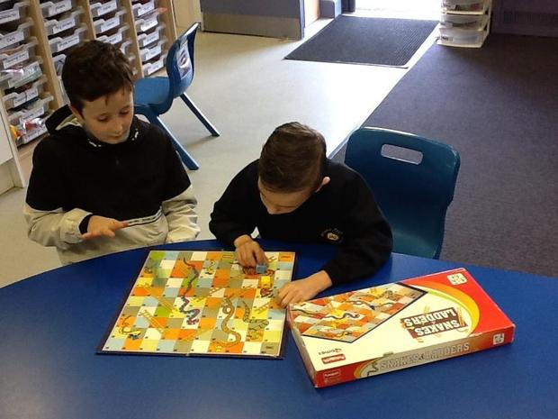 We enjoyed counting when we played snakes and ladders.