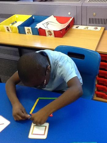 Using lolly sticks to make a pattern