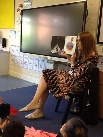 Miss B reading a story.