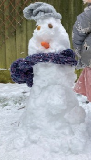 Mrs Smith and her little girl's Snowman.  Sadly, her little girl sneakily ate his nose!
