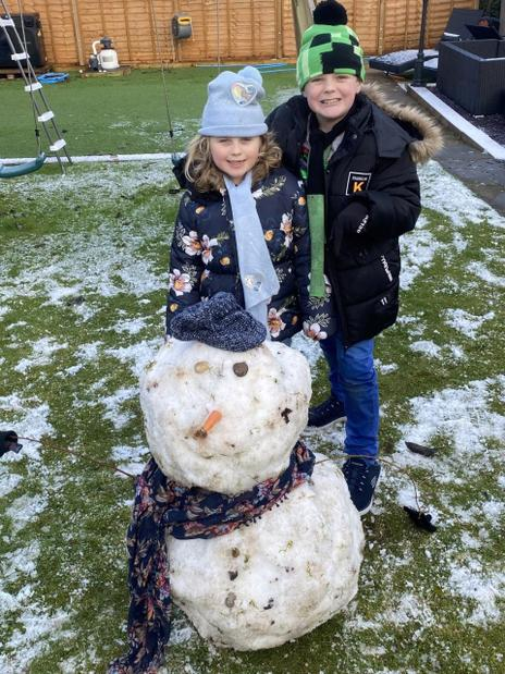Maddie and her brother's snowman!