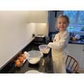 Harper's baking Daddy's cake
