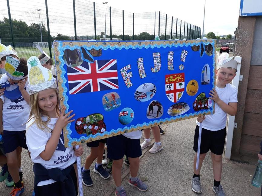 Mini Olympics, Rhydian and Megan with our banner